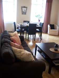 Living room with dinning area with view to Prague castle
