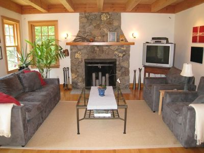Living room and custom fieldstone fireplace