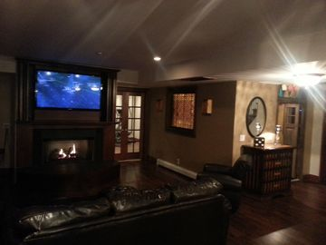 "Large gathering area features gas fireplace and 55"" flatscreen with 3D & BluRay."