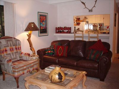 Enjoy relaxing in this very comfortable living room with doors to patio