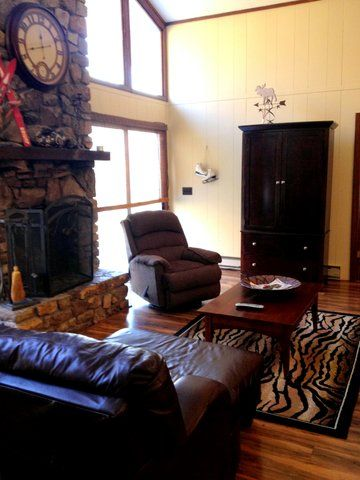 Lovely new flooring, fresh paint and a greatroom with stone fireplace!