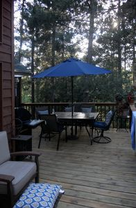 Minong chalet rental - Large L-shaped deck is a great place to have dinner or just hangout.
