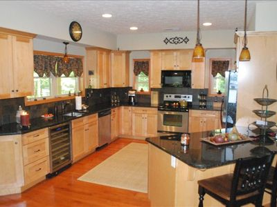 Large kitchen with SS appliances and granite countertops
