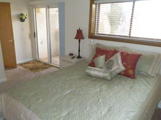 St. George condo photo - Master bedroom with queen bed with walk-out and private entrance to bathroom.