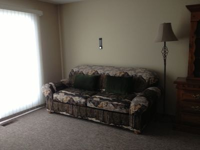 Queen sofa sleeper in master bedroom.