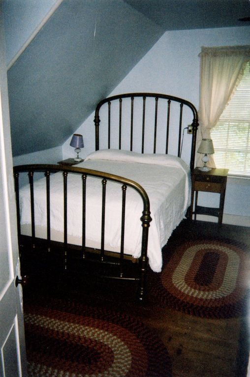 Bedroom with antique brass bed