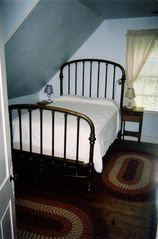 Plymouth house photo - Bedroom with antique brass bed