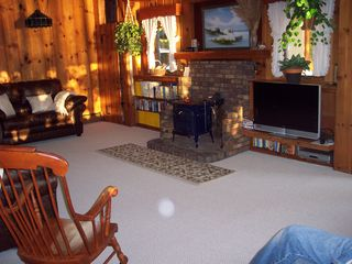 Gilford house photo - living room. 3 sofas. Basic cable tv.