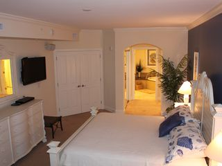 "Belmont Towers Ocean City condo photo - Master Suite with view to Master Bath. King Bed, 40"" wall mount TV"