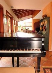 Yamaha Conservatory Grand Piano off the kitchen and living room - La Jolla house vacation rental photo