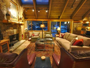 Breckenridge Peak 9 townhome rental - The Great Room that has the feel of the outdoors with large windows skylights in the vaulted timber ceiling and wood burning fireplace