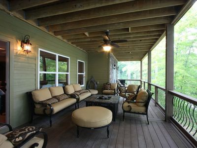 Middle deck patio seating with gas fire pit.