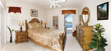 2. Bedroom with pool access and queen size bed
