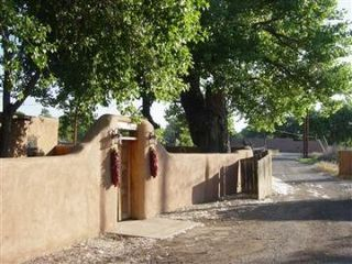 Corrales house photo - The house's main entrance and gate/driveway