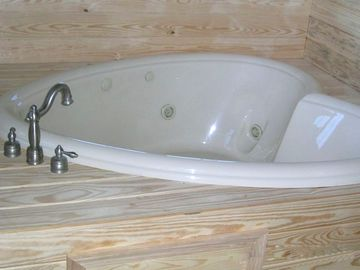 Heart Shape Jetted Tub in Master Bedroom. There are also 2 more jetted tubs.