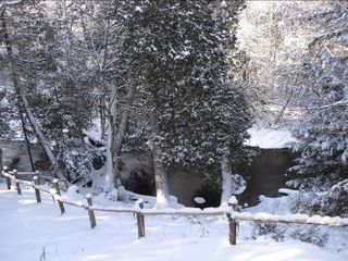 Winter view of back and river - Lake Placid house vacation rental photo