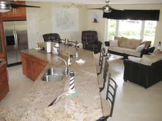 Pompano Beach house photo - Granite tiered kitchen counters and livingroom sitting area