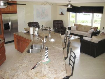 Granite tiered kitchen counters and livingroom sitting area