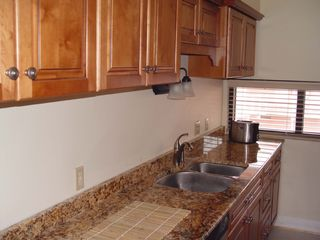 Pensacola Beach condo photo - Fully equipped kitchen with granite countertops.