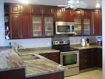 Kona Bali Kai 305 5 Star Kitchen with Custom Cherry Cabinets and Slab Granite