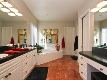 Master Bath with separate tub and shower. Double vanities and extra make-up area