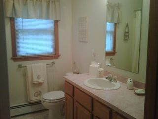 Mashpee house photo - Upstairs full bathroom. This house comes complete with towels and linens.