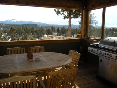 Spacious covered deck with propane grill and expansive mountain views
