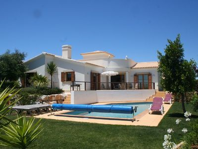 Rear view of heated pool & villa