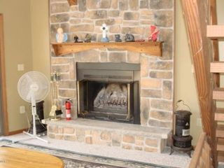 Lake Ariel house photo - Wood burning fireplace with free pre-split wood provided