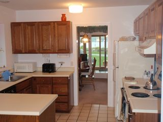 Laconia condo photo - Sitting on breakfast table looking through, kitchen, dinning room tp porch.