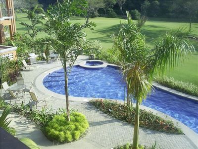 Balcony view overlooking one of the many Veranda pools and golf course.