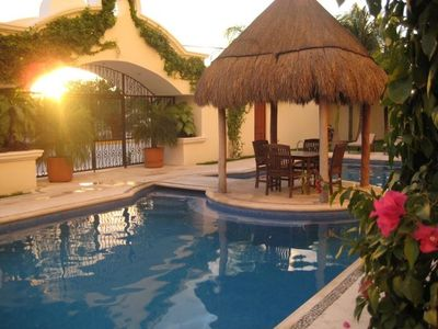 Playa del Carmen condo rental - Pool view from condo at sunset!