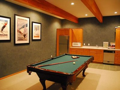 "Lower level features another kitchen, 60"" TV, DVD Player, games, a pool table"
