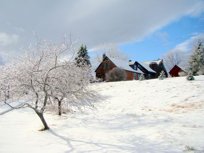 View of Farmhouse and annexed barn in Winter