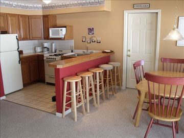 Kitchen and dining area. Connecting door to 1 bdrm condo. Rent both.