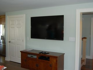 "Skaneateles Lake, Skaneateles cottage photo - 60 "" large screen TV in Living Room."
