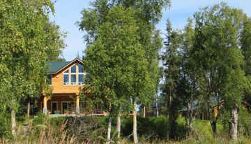 Soldotna cabin rental - A view from the river of our home, Edgewater One and Edgewater Two cabins.