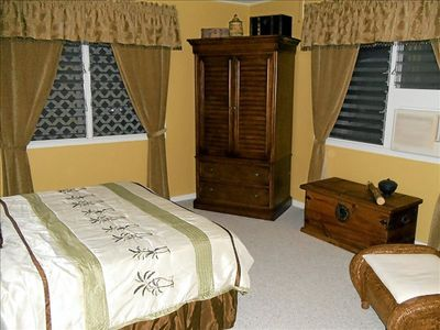 Queen size bed, armoire, 2 windows