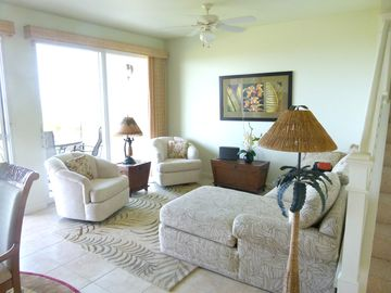 More comfortable seating in the living area which opens to the lanai.