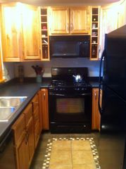 Lake Salem house photo - Tile Floor Kitchen with Fridge, Stove, Dishwasher, Microwave, Toaster Oven, More