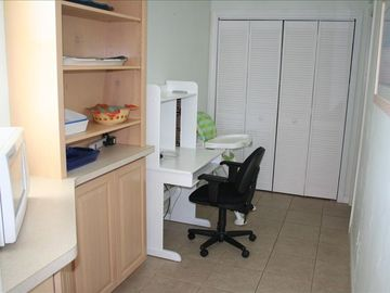 Work area next to kitchen. W & D in closet. Computer table w/ free wireless.