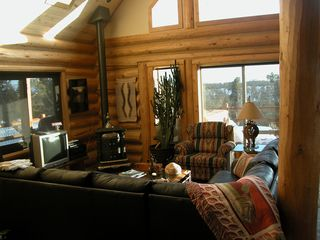 Sunny, confortable living area with huge windows facing south - Mesa Verde cabin vacation rental photo