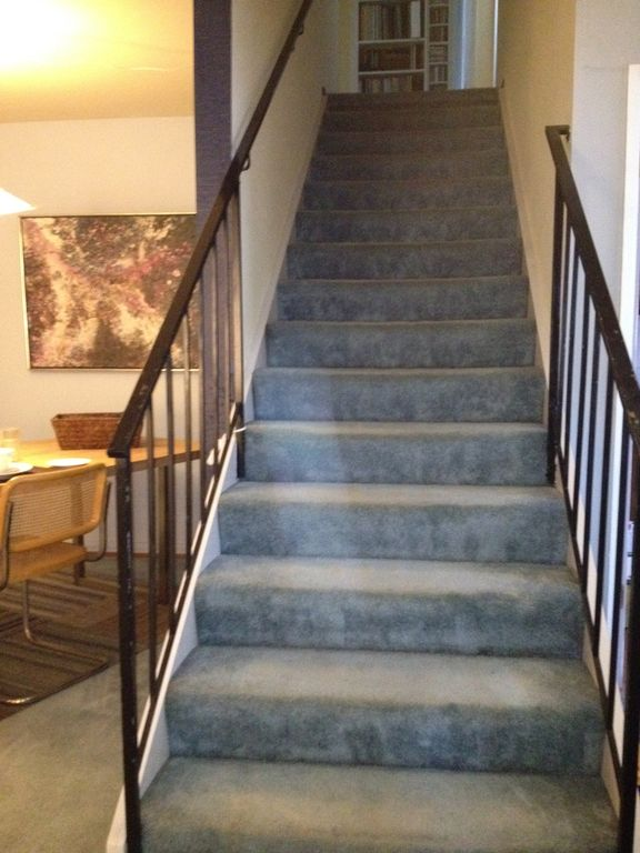 Stairway to upstairs penthouse, shared deck, and sweeping views of San Francisco