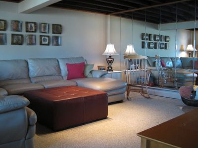 Living room has a large, comfortable leather sectional.