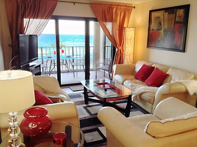 Direct  oceanfront living room with sliding door to the balcony, HDTV, DVD
