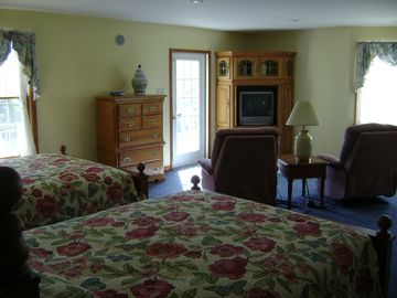 West Wing Suite - 2 Queen Beds! Door leads to a balcony.
