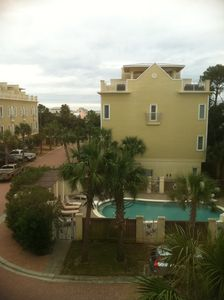 second floor view of pool and gulf
