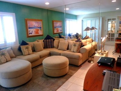 You will be so comfortable in this family room with French doors, priviate too.