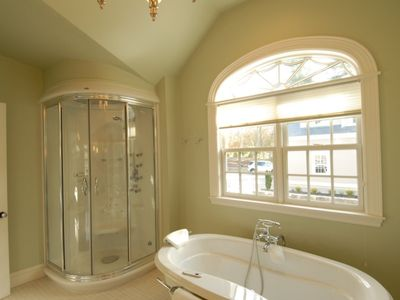Master bath with Jacuzzi tub and steam shower.