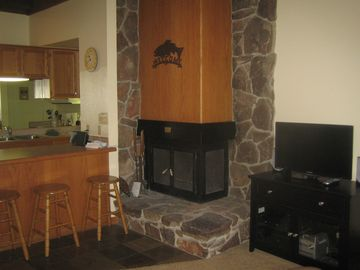 Kings Beach condo rental - Wood burning fireplace and bar